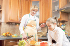 Mother and Teenage Daughter Preparing Vegetables For  Salad Stock Image