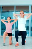 Mother and teenage girl at sports club Stock Photos