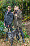 Mother and Teenage Son, Woman and Boy, Gardening Royalty Free Stock Photo