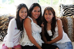Mother and teenaged daughters. Happy Asian family - mother and teenaged daughters Stock Images