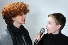 Mother and teenager son. Attractive mother and her teenager son singing together Stock Photo