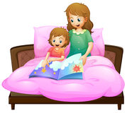 Mother telling bedtime story to kid in bed Stock Images