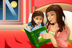 Mother Telling a Bedtime Story Stock Photos