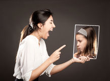 Mother telling off her daughter Stock Photo