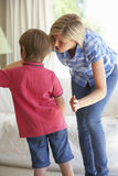 Mother Telling Off Son At Home Stock Photos