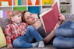 Mother telling a story to child Stock Images