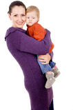 Mother tenderly holding the baby in her arms Stock Photos
