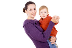 Mother tenderly holding the baby in her arms Royalty Free Stock Image