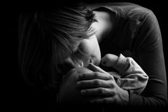 Mother Tenderly Nuzzling Baby Stock Images