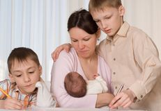 Mother with three children Royalty Free Stock Image