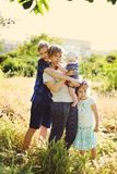 Mother and three children Royalty Free Stock Images