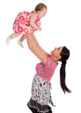 A mother throws his infant child into the air Stock Photos