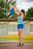 Mother throws up daughter. Royalty Free Stock Photography