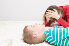 Mother is tired, child is crying Stock Photography