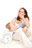 Mother is tired. Young Mother and pretty child royalty free stock images
