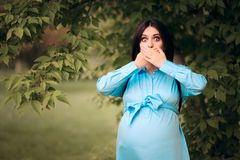Pregnant Woman with Heartburn Acid Reflux Symptom. Mother to be experiencing hyperacidity in third trimester of pregnancy royalty free stock photo