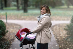 Mother and toddle taking a walk. In park Royalty Free Stock Photography