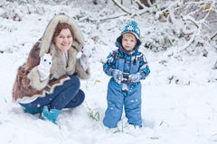 Mother and toddler boy having fun with snow Stock Photo