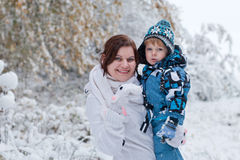 Mother and toddler boy having fun with snow Stock Images