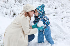 Mother and toddler boy having fun with snow Stock Photography