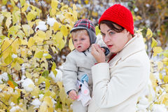 Mother and toddler boy having fun with snow on winter day Stock Photography