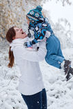 Mother and toddler boy having fun on winter day Stock Image
