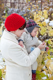 Mother and toddler boy on winter day Stock Images