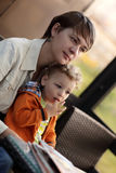Mother and toddler in cafe. Mother and toddler are waiting food in a cafe Stock Photo