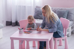 Mother and toddler child drawing and painting together.  stock images