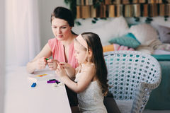 Mother and toddler daughter playing with plasticine or play dough at home Stock Image