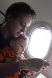 Mother with toddler on a flight Royalty Free Stock Images