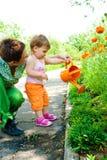 Mother and toddler in garden Stock Photos