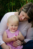 Mother and toddler holding flowers Stock Photo