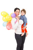 Mother and toddler with many balloons Stock Photos