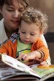 Mother and toddler with menu. Mother and her toddler choosing dish in a cafe Stock Photos