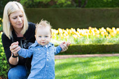 Mother and toddler in the park Royalty Free Stock Photo