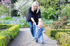 Mother and toddler in the park Stock Images