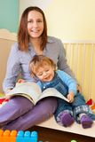 Mother and toddler reading a book Stock Photo