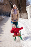 Mother with toddler on sled Royalty Free Stock Photography