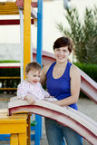 Mother with  toddler on slide playground Royalty Free Stock Photography
