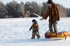 Mother and toddler on a snow Stock Image