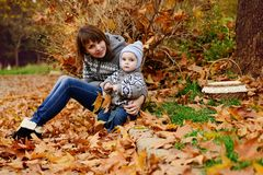Mother and toddler son in fall Royalty Free Stock Images