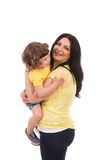 Mother and toddler son having fun. Mother embracing toddler son and having fun isolated on white background Royalty Free Stock Images