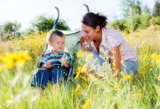 Mother and toddler son outdoors Stock Photos