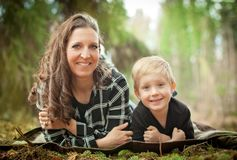 Mother and toddler son relationship. Mom and son playing in the outdoors stock photography