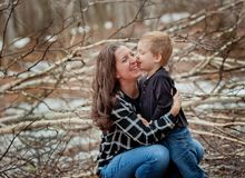 Mother and toddler son relationship. Mom and son playing in the outdoors royalty free stock image