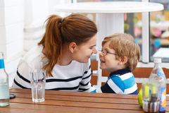 Mother and toddler son relaxing in outdoor restaurant Royalty Free Stock Photo