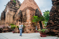 Mother and Toddler Son tourists in Vietnam. Po Nagar Cham Tovers. Asia Travel concept. Journey through Vietnam Concept royalty free stock photography