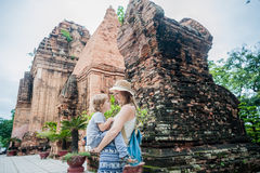 Mother and Toddler Son tourists in Vietnam. Po Nagar Cham Tovers. Asia Travel concept. Journey through Vietnam Concept stock photos