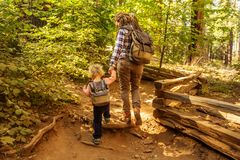 Mother with toddler visit Yosemite national park in California, USA.  royalty free stock images